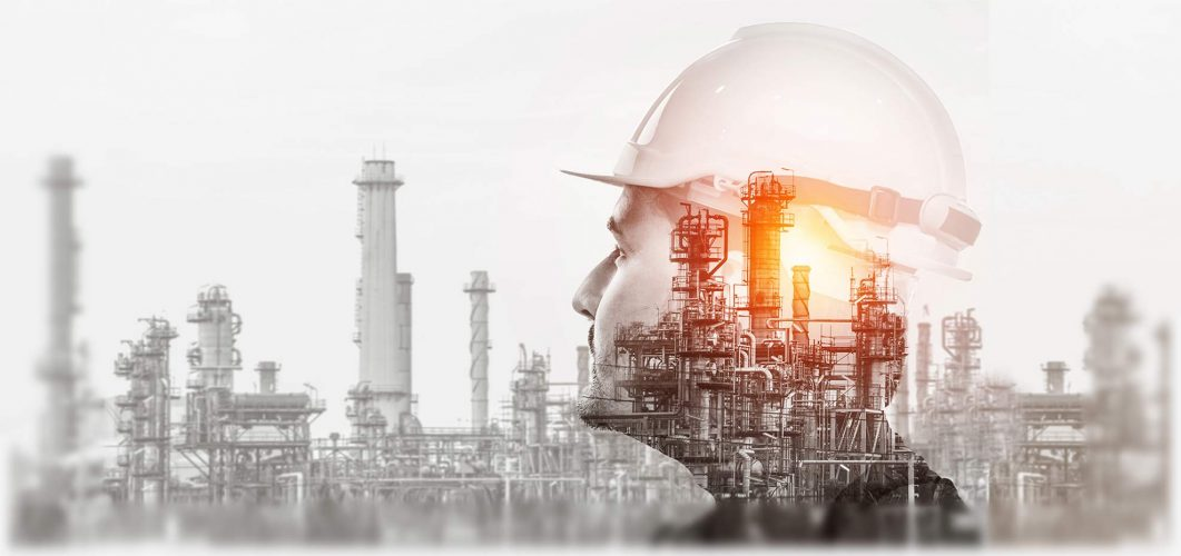 Double exposure showing man wearing hardhat and oil gas refinery.